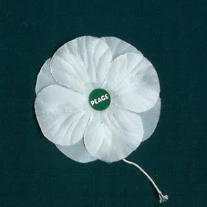 White poppy with peace in the centre